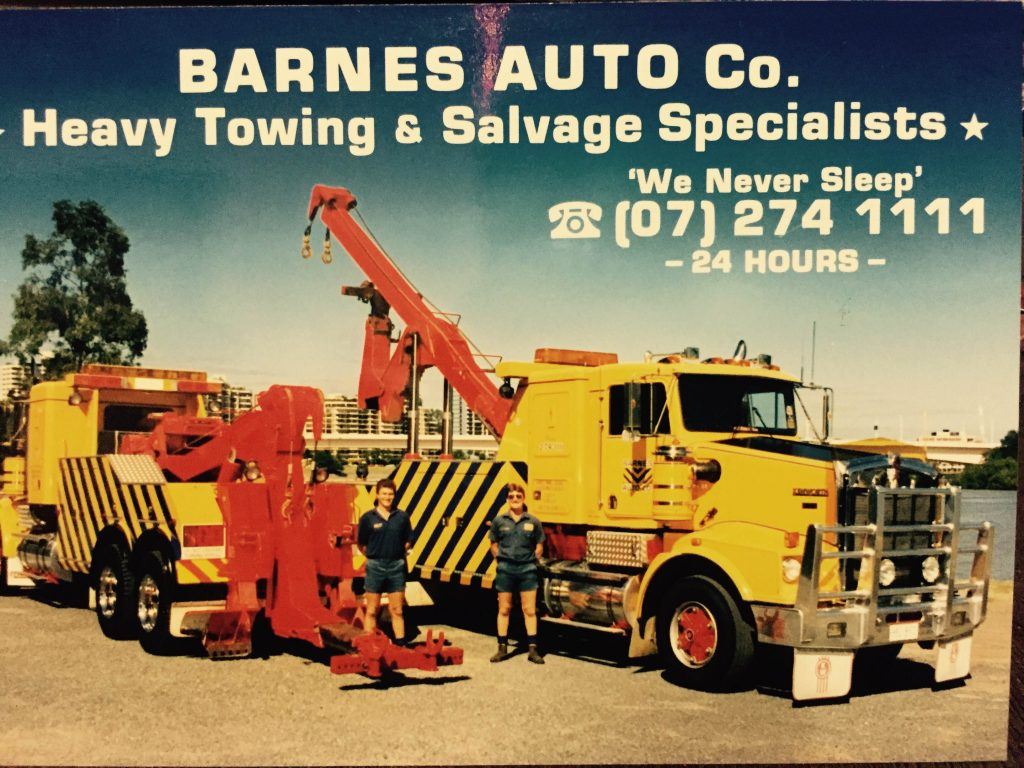 "our history archived photo, two barnes trucks with title ""heavy towing & salvage specialists"""