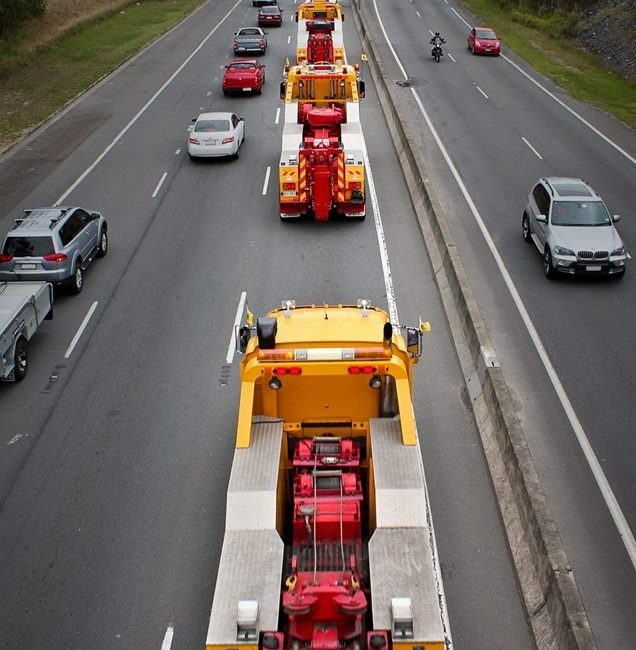 Truck convoy showing barnes fleet